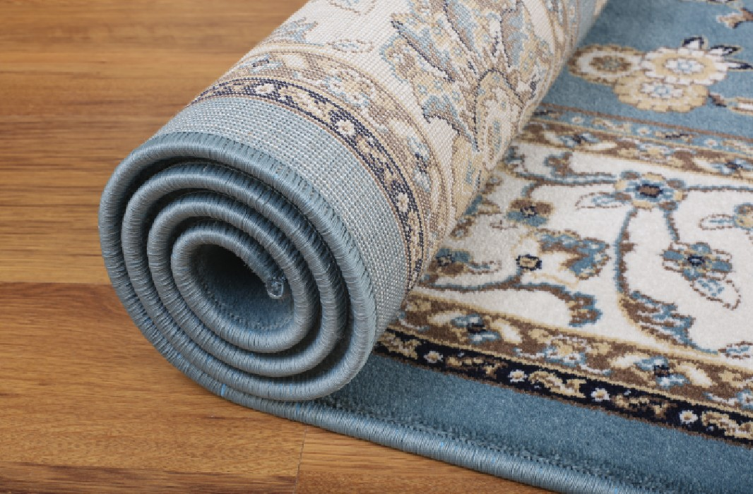 Rolling-of-a-Handmade-Rug-to-get-rid-off-bumps